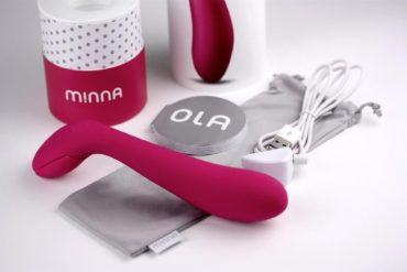 Minna Ola, a smooth slightly curved vibrator with a squeezable handle.