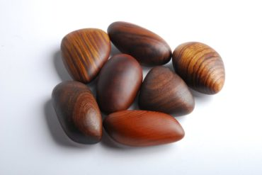 A bunch of pebble-shaped wooden objects.