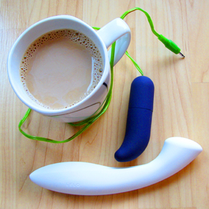 My avatar, featuring a coffee cup, the white LELO Ella G-spot dildo, and a purple bullet vibrator.