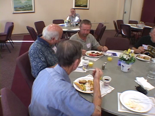 Old people eating breakfast.