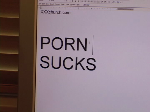 "Computer screen with a text file open which reads in a large font, ""PORN SUCKS"""