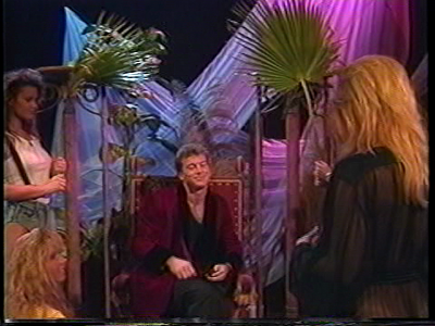 Imagine a fever dream set in the '80s, with indoor ferns and lots of robes.