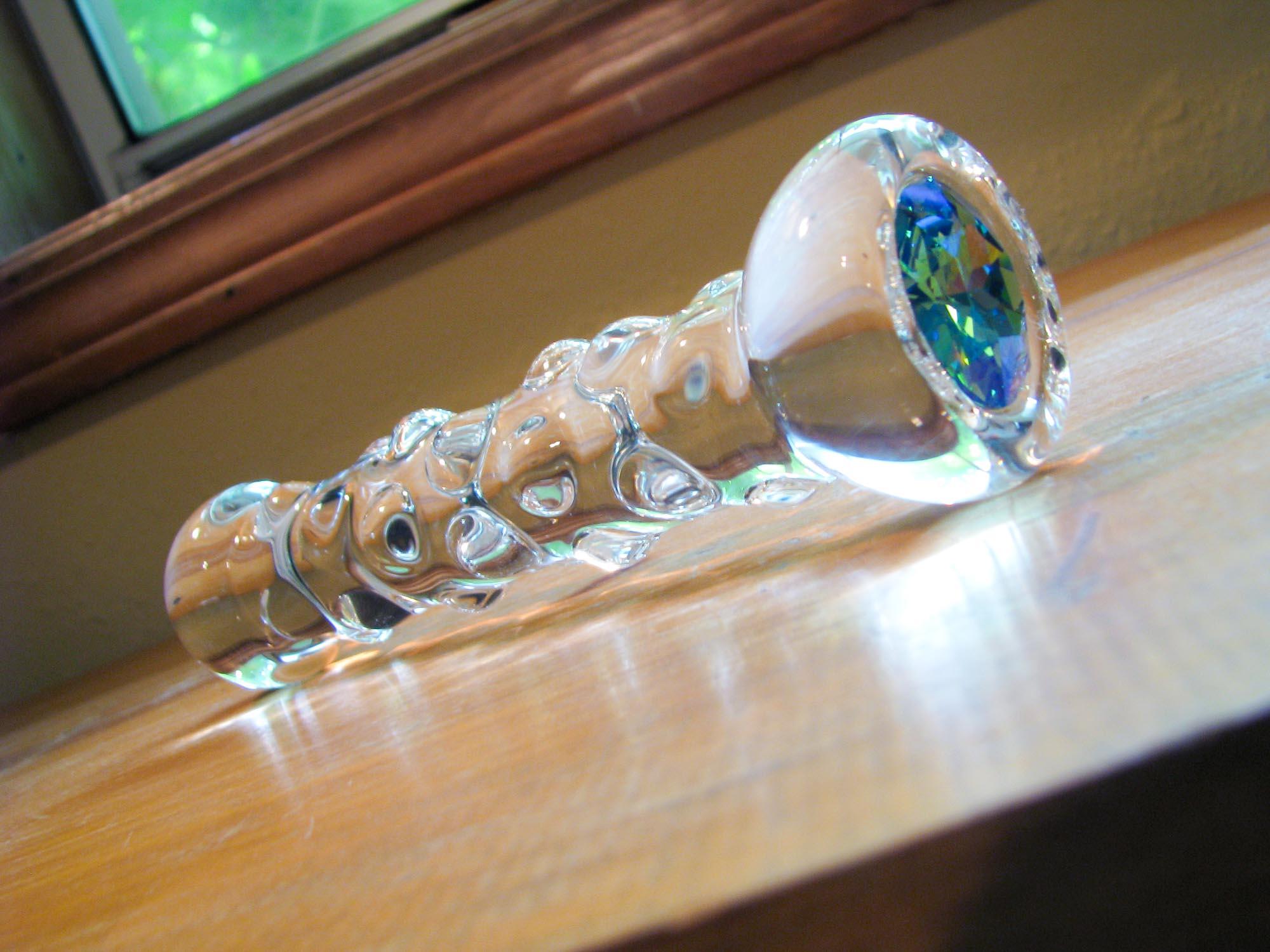 Crystal Delights Star Delight with glacier blue aqua Swarovski crystal on a wooden table.
