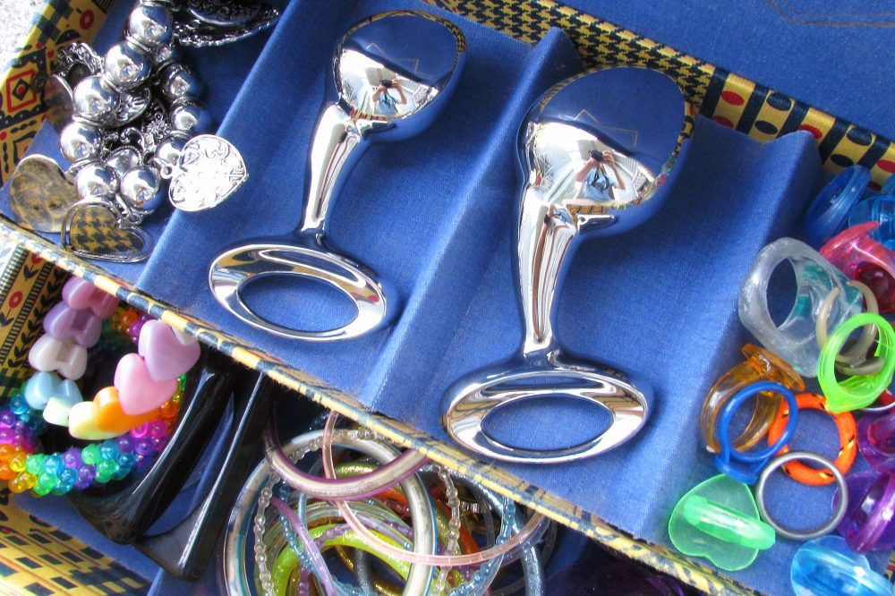 njoy Pure Plugs (medium and large) in a jewelry box with a bunch of gaudy bracelets and rings.
