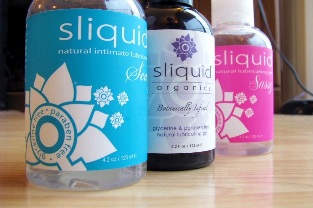 Bottles of Sliquid lined up: Sliquid Sea, Organics Gel, and Sassy.