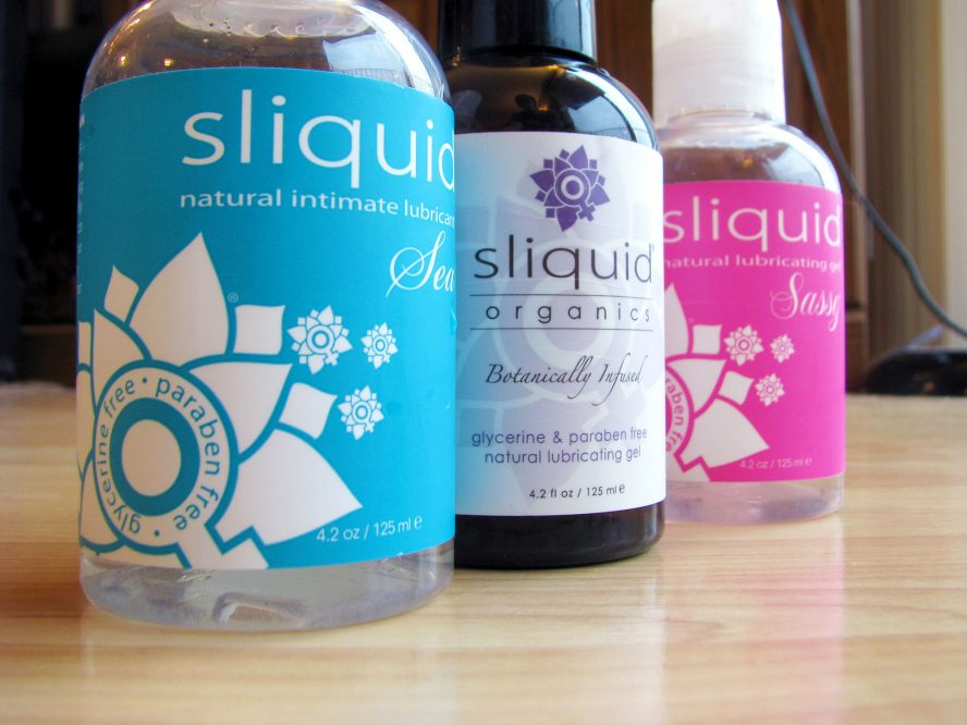 Bottles of Sliquid lined up: Sliquid Sea, Organics Gel, and Sassy.
