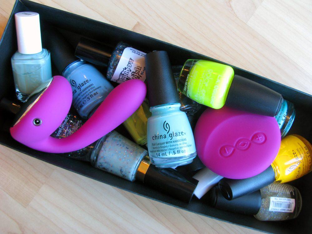 LELO Ida vibrator in a box of various nail polishes.