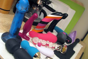 Sex toys drying on the kitchen counter.