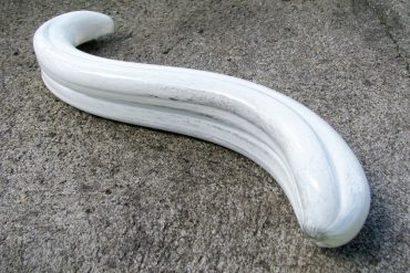 Fucking Sculptures G-Spoon large glass dildo on rough cement.
