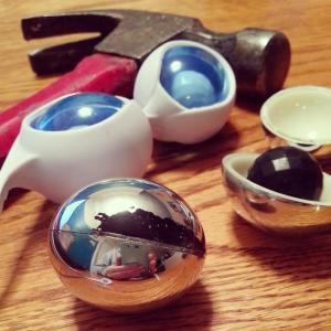Chipping silver paint and broken open OVO L1 Silicone Love Balls