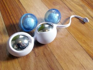 Chipping silver paint and broken open OVO L1 Silicone Love Balls. With a hammer.