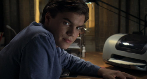 Matthew (Emile Hirsch) furtively masturbating under his desk in The Girl Next Door