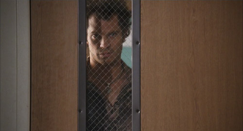 Kelly (Timothy Olyphant) in The Girl Next Door being fucking terrifying staring into a classroom through the window in the door.
