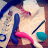 Sex toy masturbation session note taking, with dirtied toys lying on top.