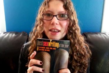 Me holding a copy of Best Sex Writing of the Year, Vol. 1