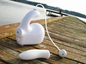 Bubble Love pleasure jet and Dilly dildo attachment on an old boat dock.
