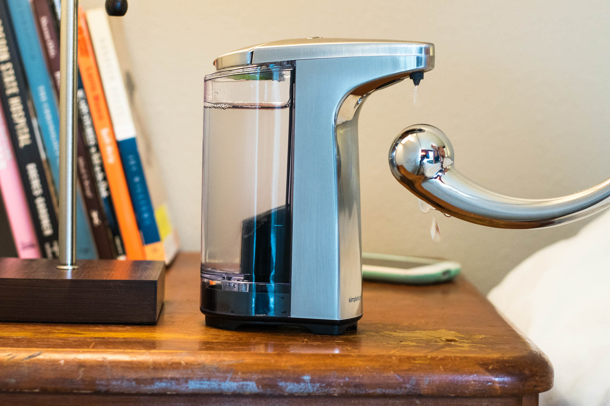 Pouring Sliquid H2O lube into the simplehuman Sensor Pump automatic dispenser.