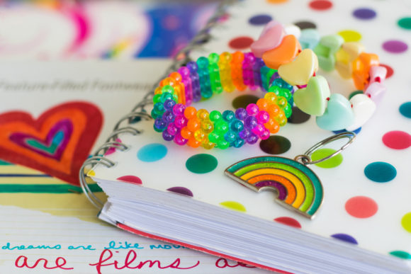 Rainbow notebook, bracelets, keychain