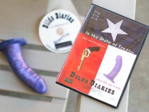 Dildo Diaries (2002). DVD sitting next to a purple dildo.