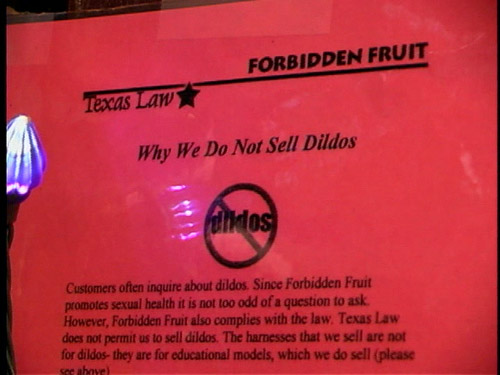 """Sign at Forbidden Fruit sex shop: """"Why We Do Not Sell Dildos."""""""