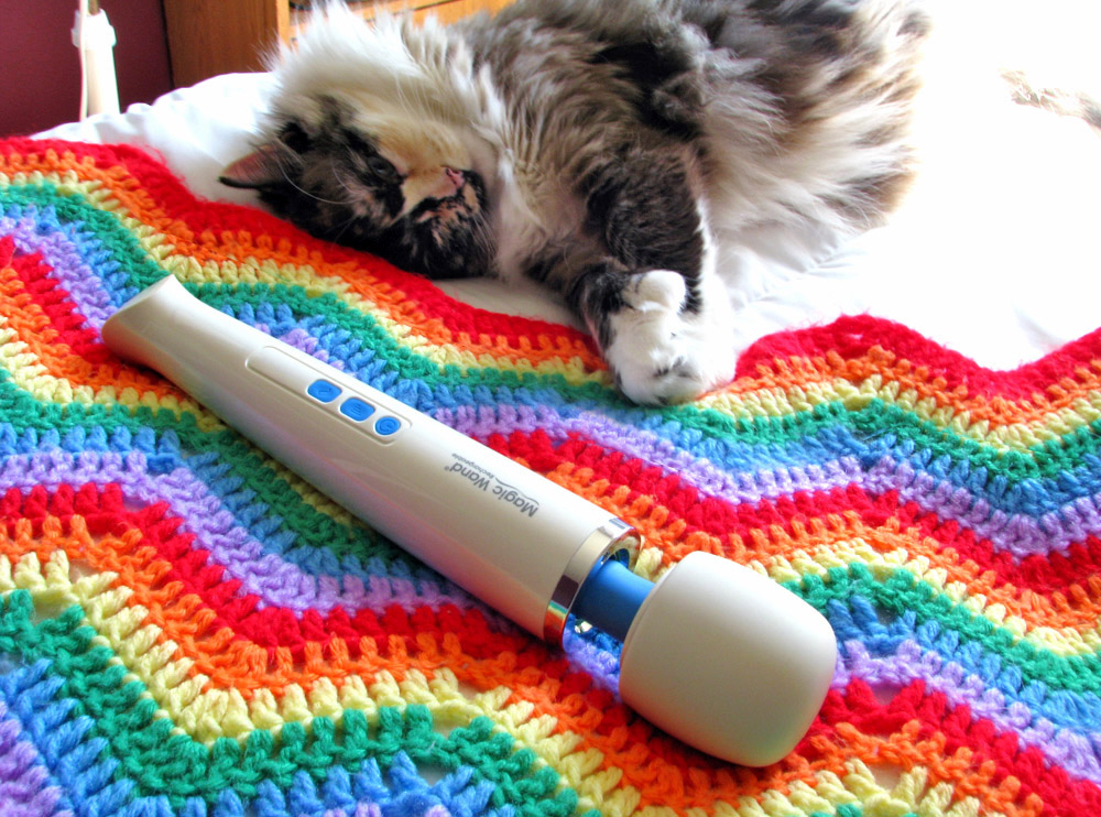 Tessa sleeping in bed with the Hitachi Magic Wand Rechargeable.