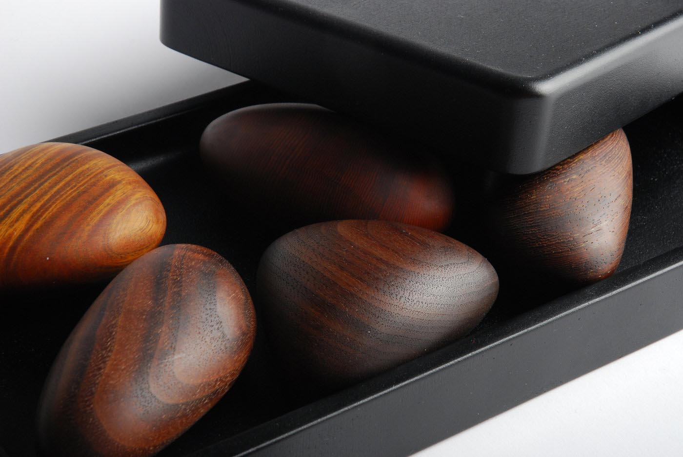 A box of pebble-shaped wooden objects.