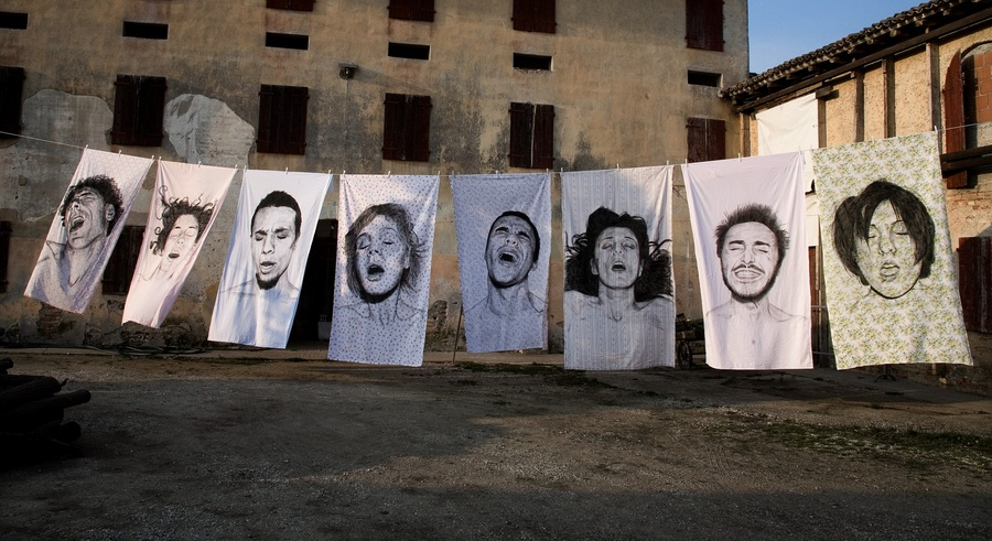 Sheets by Diego Beyró with orgasm faces printed on them.