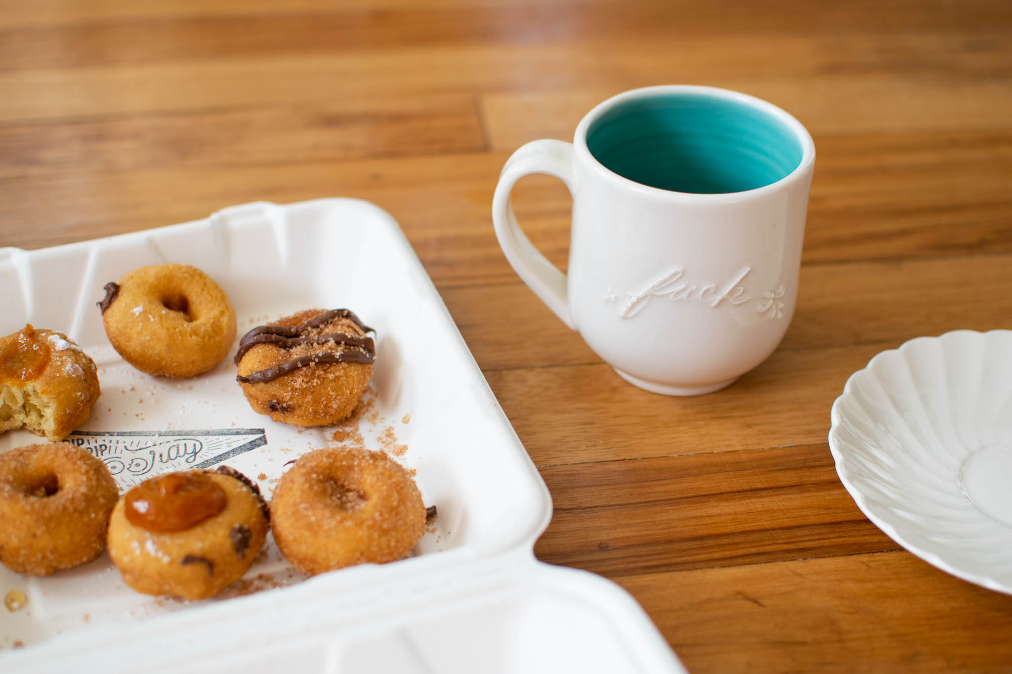 "Cute little donuts from Pip's and a mug that reads ""fuck"" in cursive."