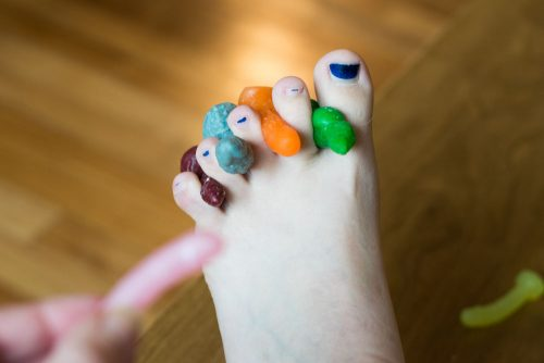 Tiny dildo mock-up photo of them acting as toe separators during a pedicure.