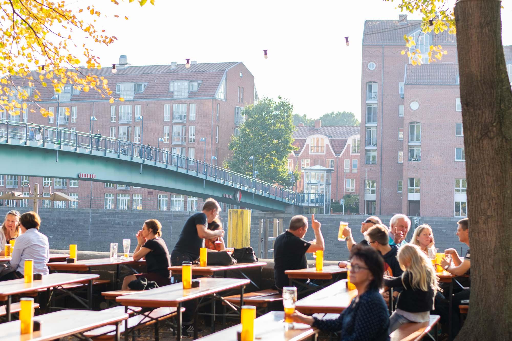 The biergarten by the Weser River in Bremen, Germany.