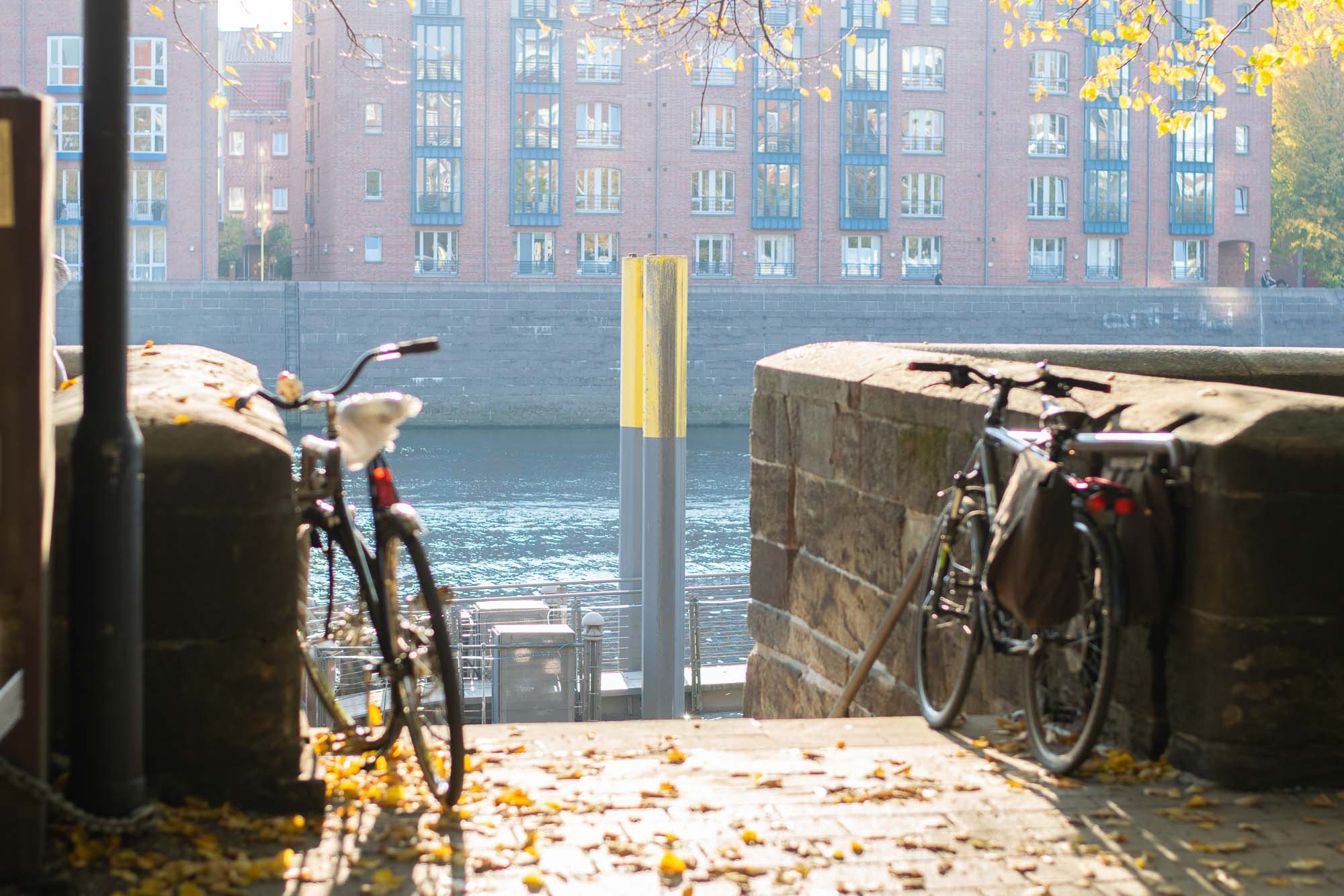 A view of bikes parked at the biergarten by the Weser River in Bremen, Germany.